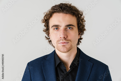 Obraz Confident handsome man in jacket posing and looking at camera - fototapety do salonu