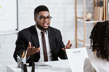 Human Resources Manager Communicating With Positive Vacancy Applicant On Employment Interview At Office