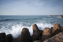 Concrete Breakwater And Splashing Waves