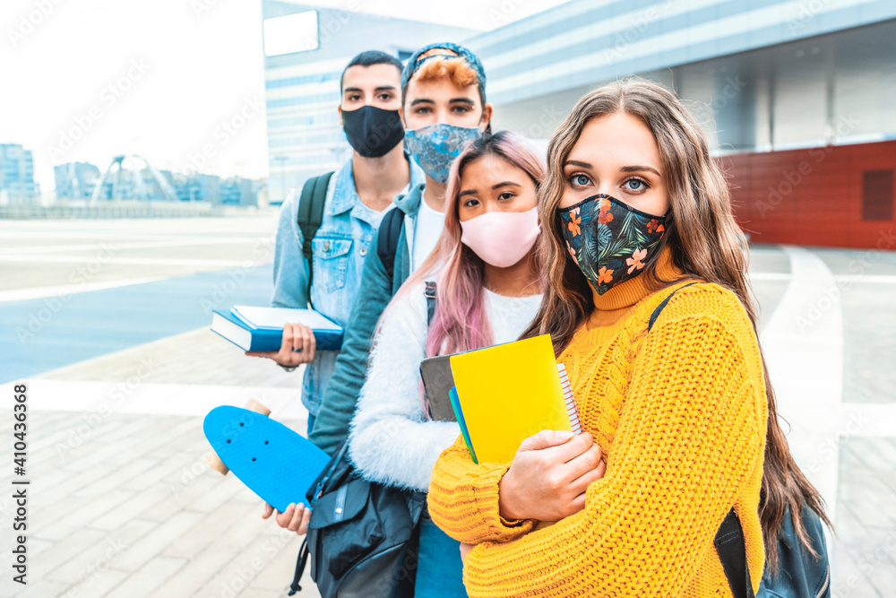Fototapeta Portrait of a group of students covered by face masks. New normal lifestyle concept with young people going to school at corona virus pandemic.