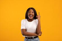Inspired Black Woman Raising Finger Up, Having Idea