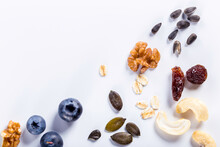 Seeds Of Sunflower, Nuts, Fruits And Dried Fruits On White Background With Copy Space.