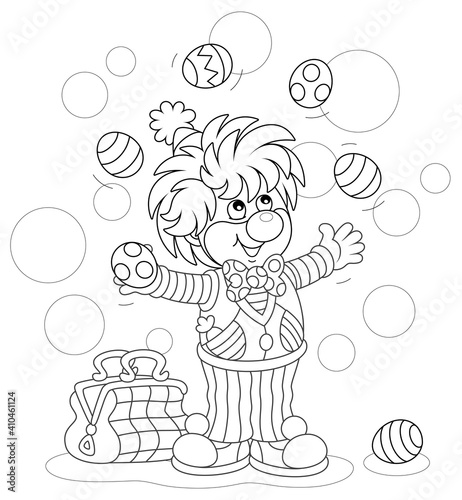Tela Funny and friendly smiling clown in a comic suit juggling with decorated Easter
