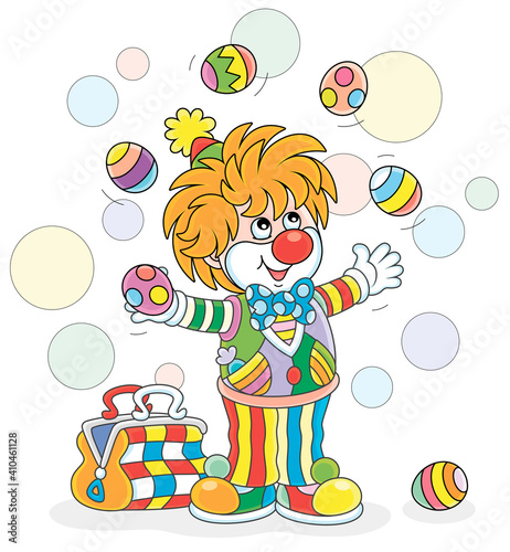Fotografia Funny and friendly smiling clown in a colorful comic suit juggling with decorate