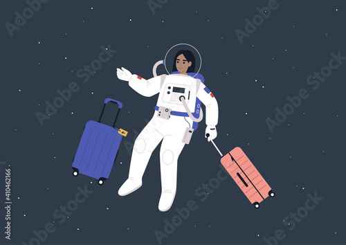 Fototapeta Space tourism concept, a young female astronaut in a spacesuit traveling with luggage in outer space obraz
