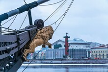 Russia, St. Petersburg, January 2021. A Jumping Lion On The Bow Of The Ship And A View Of The City.
