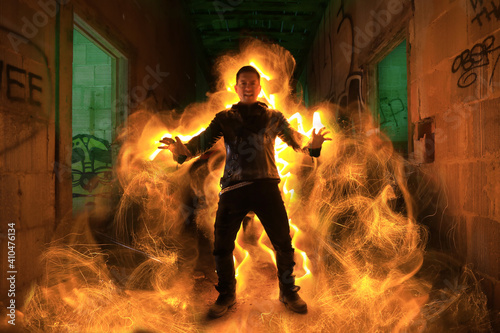 Fotografia Man in Abandoned Building Conjuring Flames