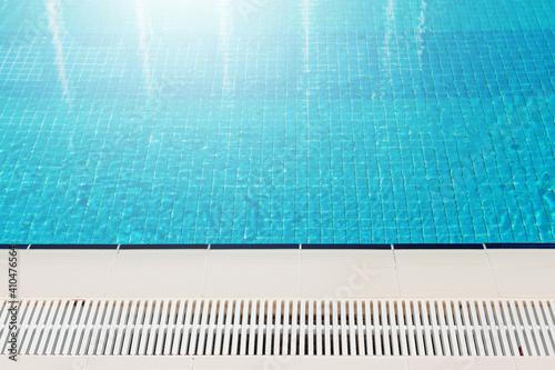 Fototapeta Sunny swimming pool in tropical resort