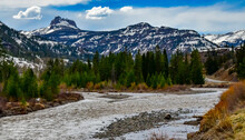 Mountain River With Muddy Water, Melting Snow In The Mountains. Mountain Landscape.