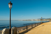 Landscape On The Boardwalk With Lighthouses And Blue Sea. Marbella, Spain.