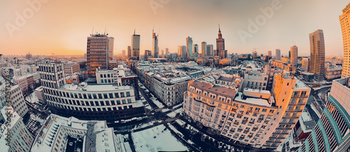 Slika na platnu Beautiful panoramic aerial drone view on Warsaw City Skyscrapers, PKiN, and Varso Tower under construction and 19th-century tenement houses during the January sunset, Warsaw, Poland
