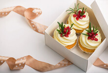 Valentines Cupcakes With Vanilla Icing In A Box On A White Background