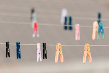 Various Colors Of Clothes Pegs On The Washing Line
