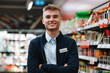 Leinwandbild Motiv Confident young supermarket worker