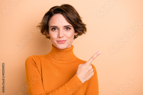 Canvas Print Photo of young pretty happy positive good mood smiling girl pointing finger copy