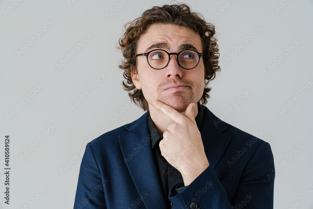Fototapeta Brooding handsome man in eyeglasses thinking and looking aside