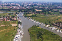 Top View Of The Tiber River At Its Confluence With The Tyrrhenian Sea Near The City Of Fiumicino. Italy