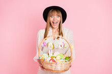Photo Of Excited Lady Hold Easter Basket Open Mouth Wear Vintage Headwear Dotted Dress Isolated Pink Color Background
