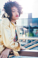 Beautiful Latin Woman With Curly Hair, Portrait Set In The City