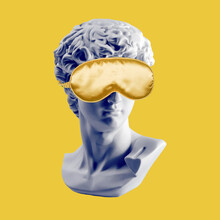 Gypsum Statue Of David Head In Golden Sleep Mask, Ancient Greek Sculpture. Creative, Sleep, Spa And Relax Concept. Minimal Concept Art. Last Or Blind Judgment. Toned Picture