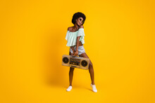 Full Length Body Size Photo Of Black Skinned Girl Boombox Enjoying Music Dancing Isolated On Vivid Yellow Color Background