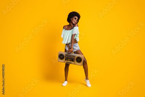 Fotografija Full length body size photo of black skinned girl boombox enjoying music dancing