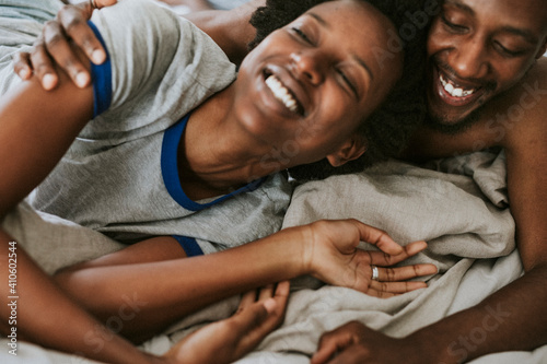 Obraz Cute happy black couple playing in bed - fototapety do salonu