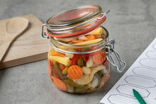 Glass Jar With Homemade Pickled Vegetable Mix Close Up