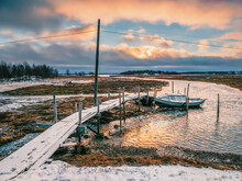 Low Tide. Fishing Pier In The Authentic Northern Village Of Umba. Kola Peninsula, Russia.
