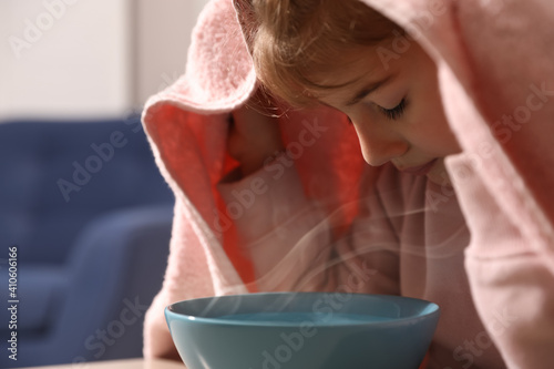 Obraz Little girl covering head with towel and inhaling steam indoors, closeup - fototapety do salonu