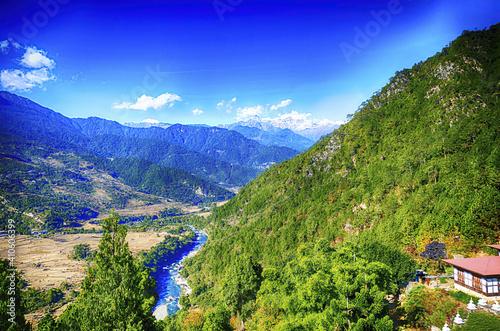 Obraz na plátně Aerial shot of rice paddies on steep mountainside near Punakha,  Bhutan