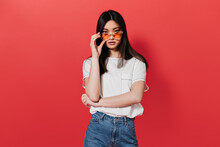 Asian Girl In White T-shirt Takes Off Her Sunglasses