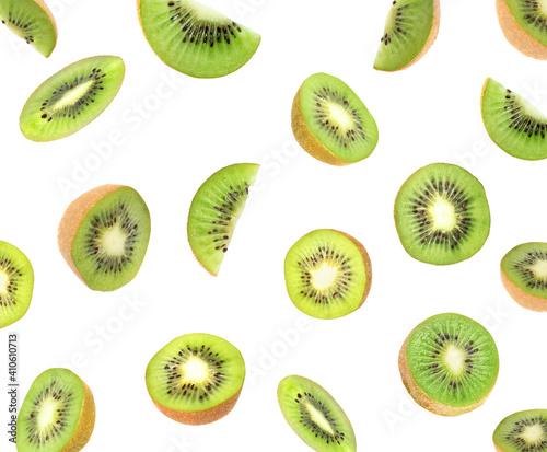 Set with cut ripe kiwi fruits falling on white background Wallpaper Mural