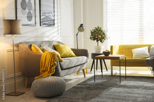 Obraz Stylish living room with sofas. Interior design in grey and yellow colors - fototapety do salonu