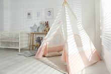 Comfortable Crib And Play Tent In Baby Room. Interior Design