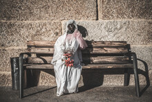 Mannequin Dressed As A Ghost Bride For Halloween Sitting On A Wooden Bench Outdoors