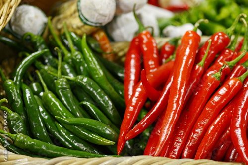 red and green peppers red hot chili peppers © Iliya Mitskavets