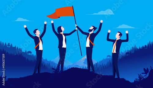 Obraz na płótnie Team building - Successful winning team of businesspeople standing on hilltop raising flag of victory while cheering