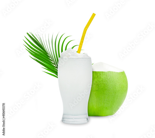 Coconut Smoothie in glass cup with green leaves pattern isolated on white background © sirawut