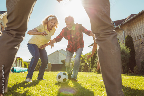 Obraz Elderly people having fun playing football - fototapety do salonu