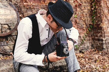 Man Taking Picture With Vintage Medium Format Photo Camera