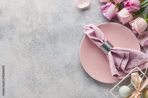Photo Easter table setting with floral decor on grey table