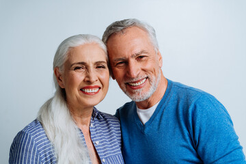 Happy senior couple posing in a studio for a photoshooting