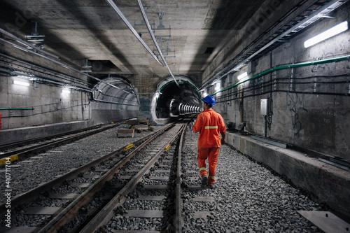worker walking at railway tunnel Fototapeta