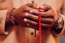 Hand Holding A Muslim Beads Rosary Or Tasbih On A Praying Mat, Pray To God. Ramadhan Kareem.