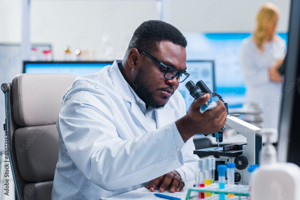 Fototapeta Professional team of scientists is working on a vaccine in a modern scientific research laboratory. Genetic engineer workplace. Future technology and science.
