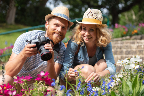 Obraz na plátne portrait of horticulturist young couple taking photos