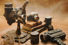Old Style Movie Projector Still Life And Photo Camera