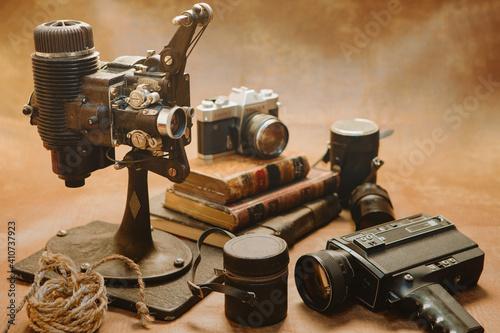 Fototapeta old style movie projector still life and photo camera obraz