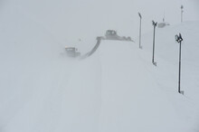 Snow Groomer By Street Lights On Field